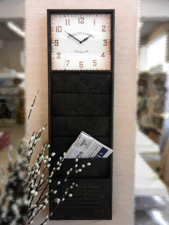 ρολόι τοίχου μεταλλικό με θήκες για περιοδικά