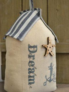 Door stoplittle house on the beach